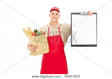 Young market vendor holding a clipboard and a grocery bag isolated on white background