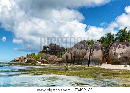 Close up Beautiful Clear Lagoon Water and Big Rocks on the Beach Side, Located at the Island of Seychelles.