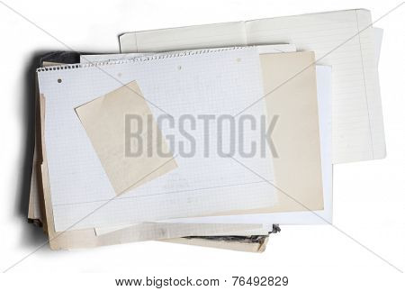 Sheet of yellowed and square graph paper on pile of aged papers