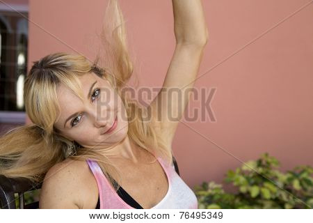Spirited Young Female Model Playing With Her Hair