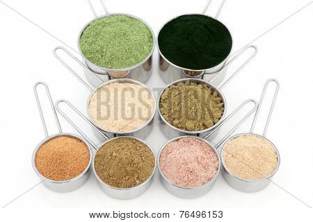 Body building and health food supplement powders over white background. Wheatgrass, spirulina, macca root, hemp, pomegranate, ginkgo biloba, chocolate whey, ginseng. Top to bottom, left to right