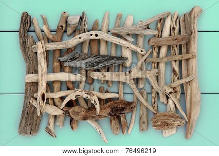 Driftwood abstract design on wooden green background.