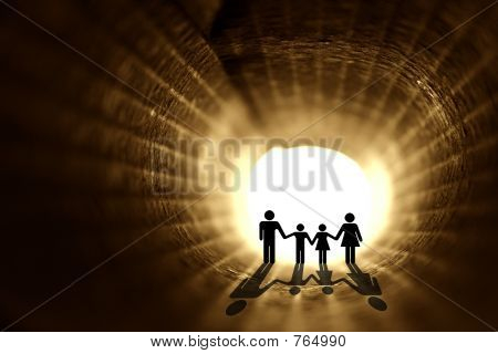 In to the light. Family silhouette inside the rolled paper