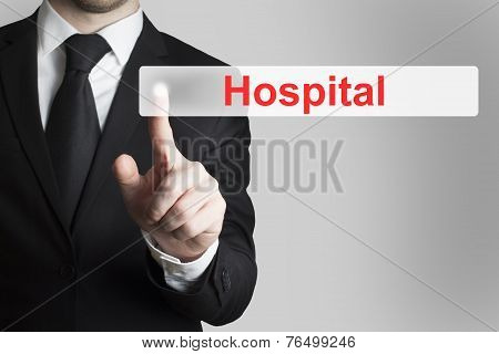 Businessman Pushing Flat Button Hospital