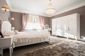 picture of enormous  - Enormous luxury old fashioned bedroom with crystal chandelier - JPG