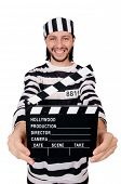image of inmate  - Funny prison inmate with movie board isolated on white - JPG