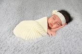 image of girlie  - Newborn baby girl of Caucasian and Asian heritage wearing a lace head band - JPG