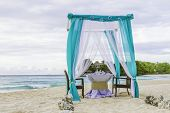 stock photo of wedding arch  - wedding arch and set up on beach - JPG