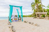 image of cabana  - wedding arch and set up on beach - JPG