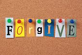 pic of forgiven  - The word Forgive in cut out magazine letters pinned to a corkboard - JPG