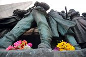 image of burial  - Flowers are left at the Soviet war memorial  - JPG