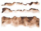 stock photo of edging  - Burned paper edges isolated on white background - JPG