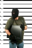 stock photo of mug shot  - A Burglar in a Black Ski Mask - JPG