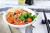 pic of chinese parsley  - Chinese noodles with vegetables and roasted meat in bowl on napkin - JPG