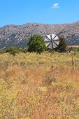 image of windmills  - Irrigation windmills are the symbol of the Lasithi Plateau Crete Greece. White-sailed windmills have been used for decades to irrigate the land. ** Note: Visible grain at 100%, best at smaller sizes - JPG
