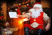 stock photo of letters to santa claus  - Santa Claus reading letters from children - JPG