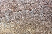 Постер, плакат: Background texture and pattern of an old weathered stone wall with natural rock cut into irregular s