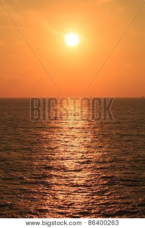 Yellow Sunset In The Middle Of The Ocean