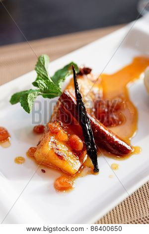 Grilled pineapple cooked in syrup, tasty dessert