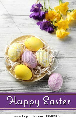 Easter composition with colorful eggs on wooden table background