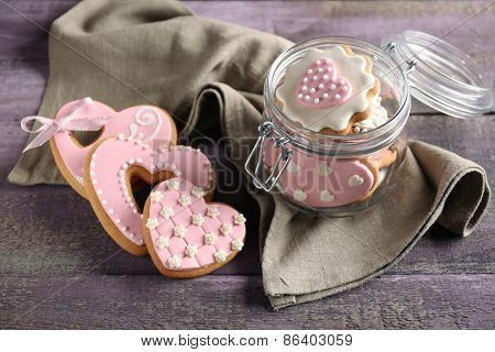 Heart shaped cookies for valentines day in glass jar on  wooden background