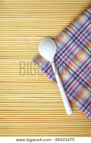 White Plastic Spoon On Linen