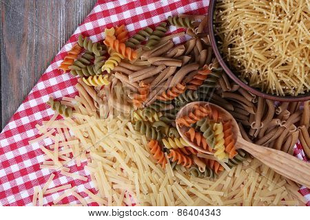 Different types of pasta on napkin close up