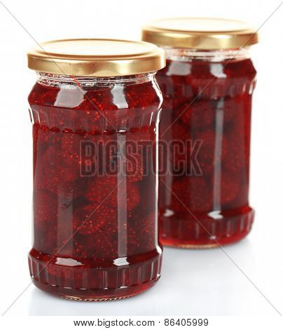 Jars of strawberry jam isolated on white
