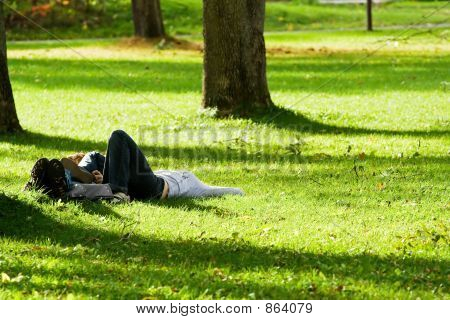 Romantic couple lying on the grass