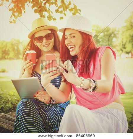 Two millennial young women outdoors in summer