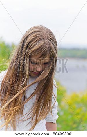 Cute Girl Playing With Long Hair