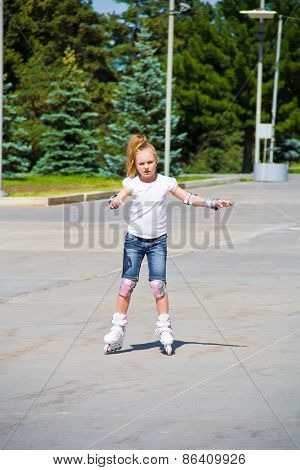 Learning Girl On Roller Skates