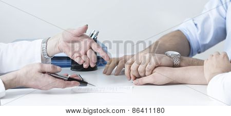 Husband Holding Wife's Hand