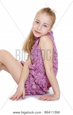Girl sitting in a fancy purple dress
