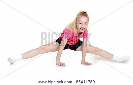 Girl in shorts sit on twine.
