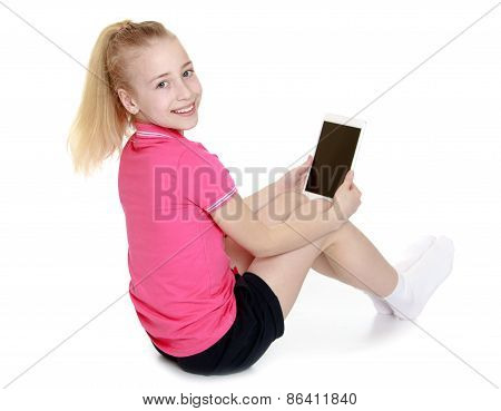 Girl sitting with a tablet PC or e-book