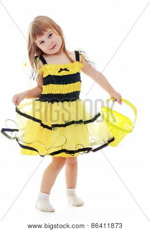 The girl in the bee costume holding a bucket