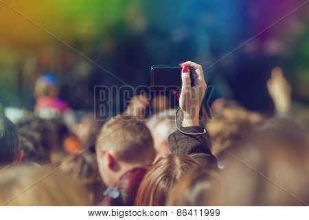 Fans Photographing Music Band Live Performing On Stage