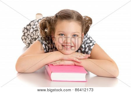 Girl lying on the floor with his hands