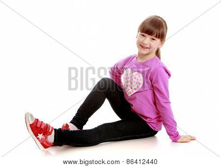 Girl sitting on white background