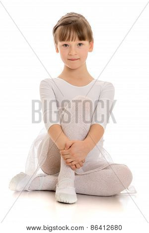 Girl in white dress sitting on the floor