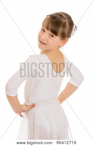 Girl in white gymnastic leotard looks over his shoulder
