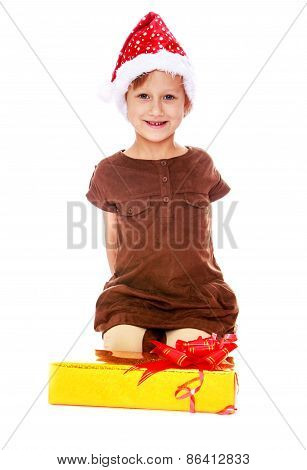 Girl sitting in front of the box