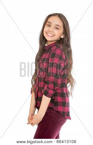 Joyful girl with long dark hair and a plaid shirt