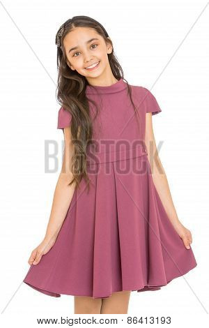 The dark-haired girl in a beautiful purple dress