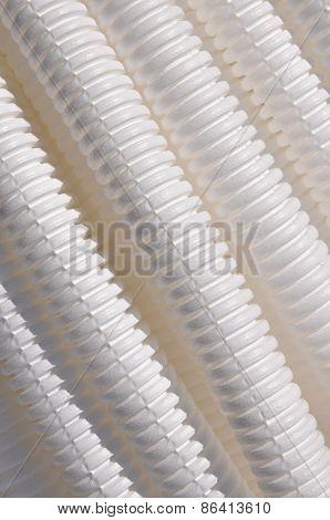 White plastic corrugated pipe