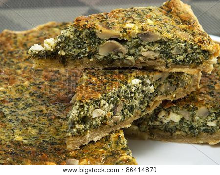 Quiche With Spinach, Cheese And Mushrooms