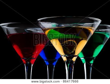 Close Up Of Color Cocktails In Martini Glasses