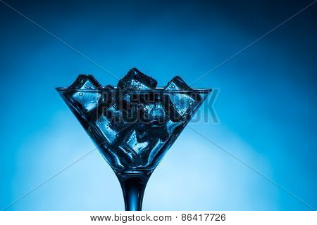 Close Up Of Martini Glass Filled With Ice Cubes