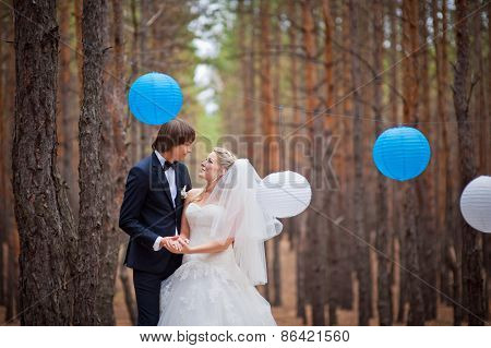 Happy Bride And Groom Walking In The Autumn Forest